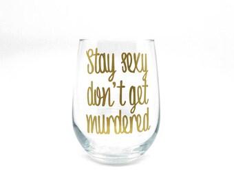 "My Favorite Murder ""Stay Sexy Don't Get Murdered"" Stemless Wine Glass"