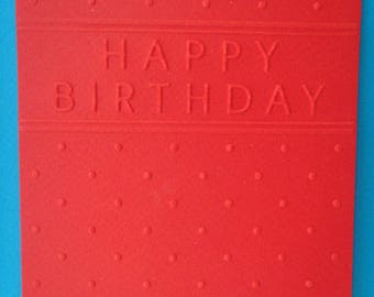 "Cut out ""Happy Birthday"" embossed red card background"