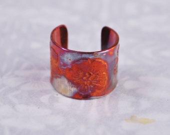 Copper flower earcuff, coloured copper earcuff, etched earcuff