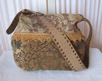 Vintage upholstery Messenger bag with heavily studded leather belt strap in browns and tans with golden fringe tote bag gypsy hippie bag