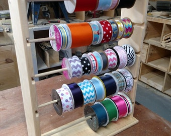 Ribbon rack organizer holds  spools of 4 and 5 inch natural