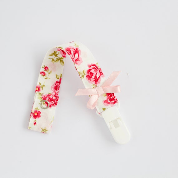 White with deep pink roses dummy clip/ pacifier clip featuring a pink satin bow