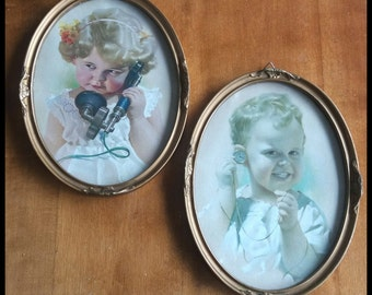 Vintage two framed oval mid-century wall hanging picture of a girl and a boy