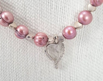 "17"" pink pearl necklace with matching bracelet."