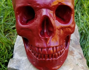 Realistic life size painted concrete skull - cabernet red