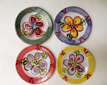 4 appetizer plates painted with flowers which I call garden graffiti….painted with lime green….red….purple…dark green…*