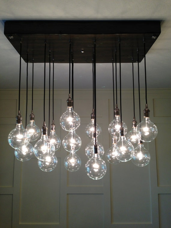 Custom industrial chandelier with modern glass pendants aloadofball Choice Image