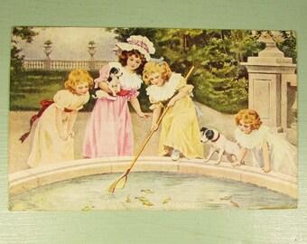 Little Girls Childhood Pleasures Postcard - Vintage Cancelled Stamp Park Fish Pond Dogs