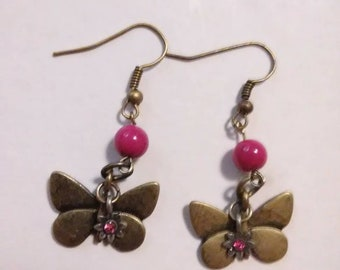 Brass butterfly earrings with purple accents