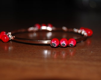 Wire wrapped beaded bracelet, rose gold with shimmery red beads