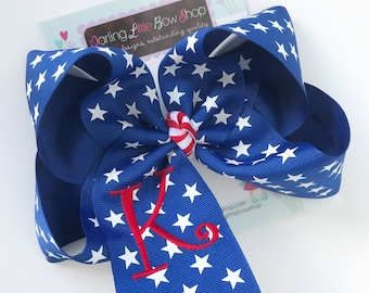 """Monogrammed Bow in royal blue stars ribbon with red initial, choose 4-5"""" or 6-7"""" bow"""