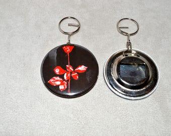 "bottle opener and keychain ""Violator"" the round is 5.8 cm diameter"