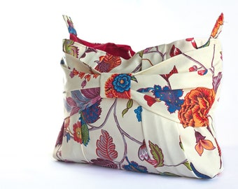 Beige handbag with colorful flowers