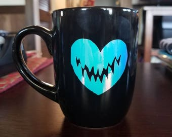 Creepy heart coffee mug