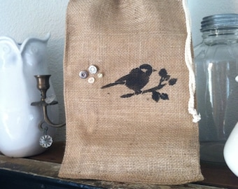 Burlap travel bag with bird and vintage buttons
