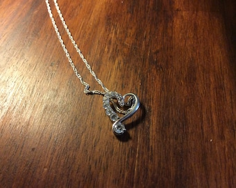 Heart shaped charm necklace with crystal set in silver