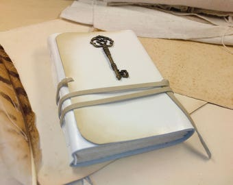 white leather journal with antique style key - white leather diary, old aged paper - Silencio