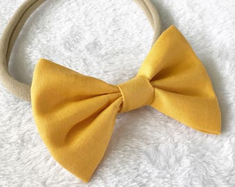 Mustard hair bow. Yellow hair bow. Mustard yellow hair bow. Fall hair bow. Pig tail bows. Hair bows. Hair accessories. Nylon headbands.