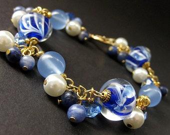 Blueberry Swirl Lampwork Glass and Chalcedony Charm Bracelet. Handmade Jewelry by Gilliauna