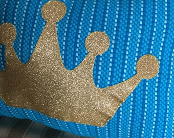 Golden Crown on Turquoise Pillow