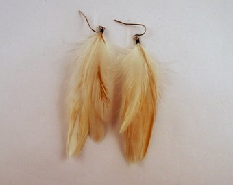 cruelty free feather earrings small white natural