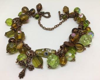 Green themed Copper charm bracelet.