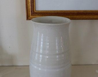 Creamy white ceramic vase.