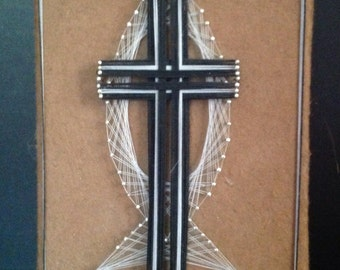 vintage l970's retro string art religious Christian symbols cross and Ichthus fish icons in black and white on brown felt over wood