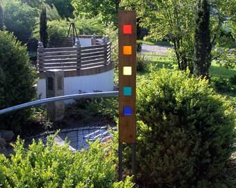 Garden sculpture made of wood and glass