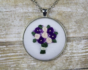 "Hand Embroidered Purple and White Flowers Bouquet Pendant Necklace. 38mm (1.5"") Silver Circle Bezel Pendant. 24"" Chain."
