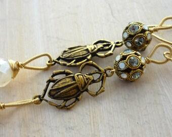 Gold scarb beetle & vintage rhinestone ball dangle earrings.