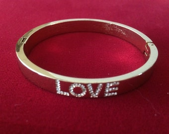 """Hinged Gold Tone """"Love"""" Bangle Bracelet with Clear Crystals"""
