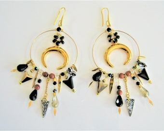 Golden earrings decorated with horns, gemstones and swarovski crystals. Model unique Bohemian ready to offer for mother's day