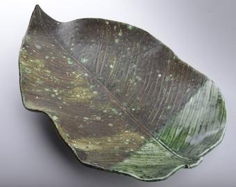 Ceramic leaf-shaped dish.