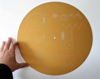Full size metal replica of NASA Voyager Golden Record cover, laser engraved on anodised aluminium. Celebrate the 40th anniversary of Voyager