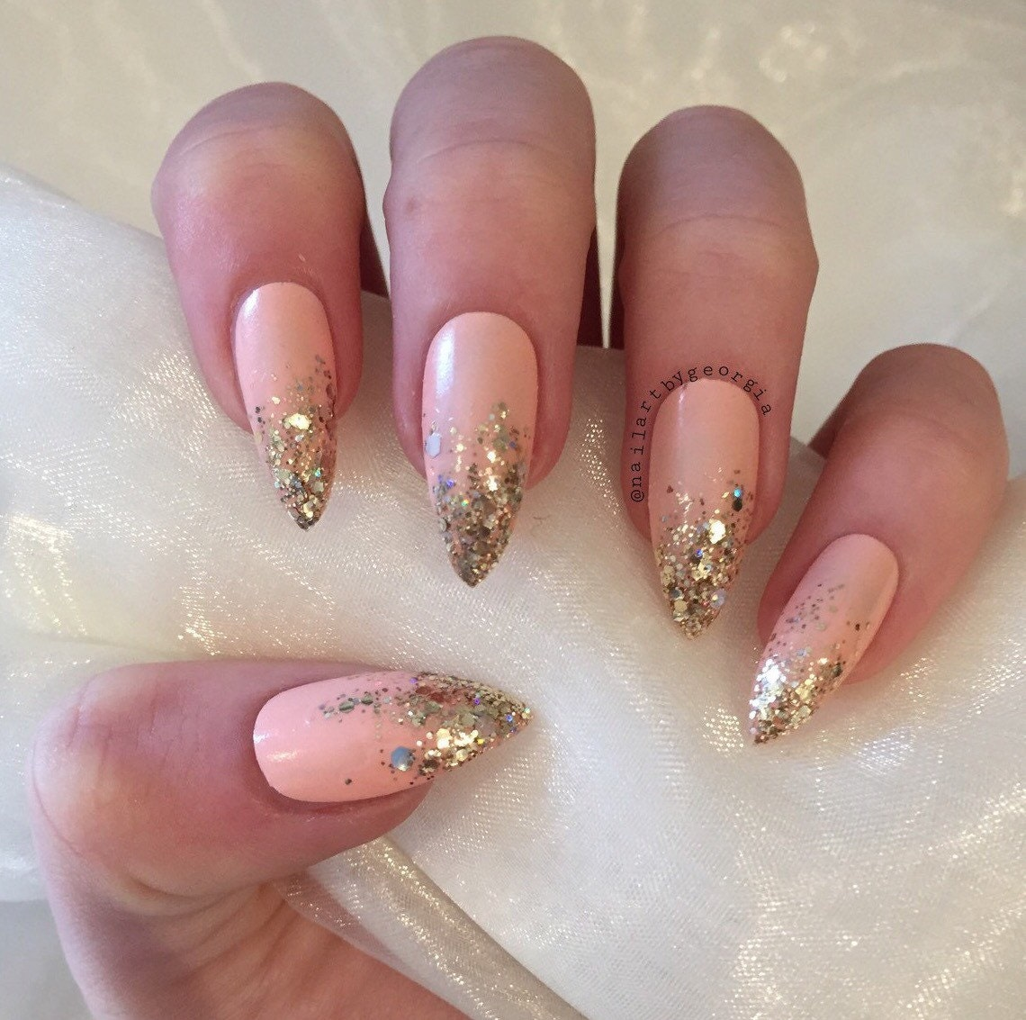 peach stiletto false nails with gold glitter ombre