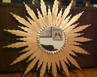 "Sunburst Mirror in gold (appx 32"" diameter)"