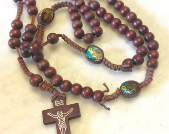 Vintage 1950's wood rosary with epoxy holy family pictures.