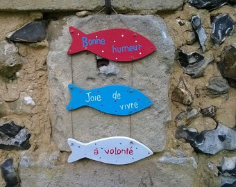 wooden fish sign and message