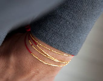 Delicate bracelet gold or silver on red silk