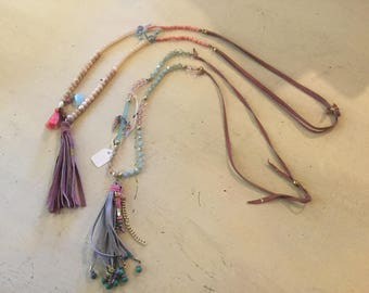 Long necklaces of natural stones, beads with charms