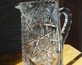 "Vintage 8""×7 1/4""×4"" Cut Glass Pitcher. From the Early 20th Century. Minor Damage of about 1"". View all Pictures Carefully. Nicely Priced."