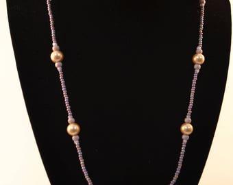 Handmade beaded necklace with purple focal bead