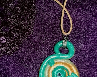 Swirling Sanctity Polymer Clay Necklace