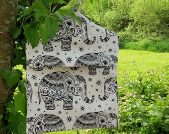 A peg bag with a whimsical elephants design.  Peg storage.  Laundry.