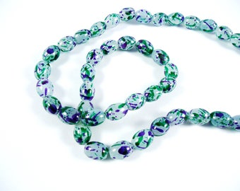 20 green and purple oval glass beads spray painted