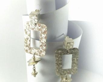 Hammered silver earrings, voluminous, light, geometrical, luminous, Italian design, single piece, handmade.