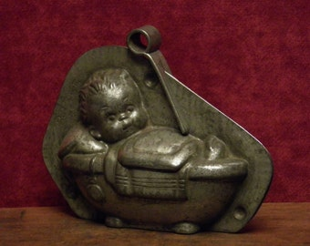 Antique two part chocolate mold of a sweet baby child in the bath by Anton Reiche.