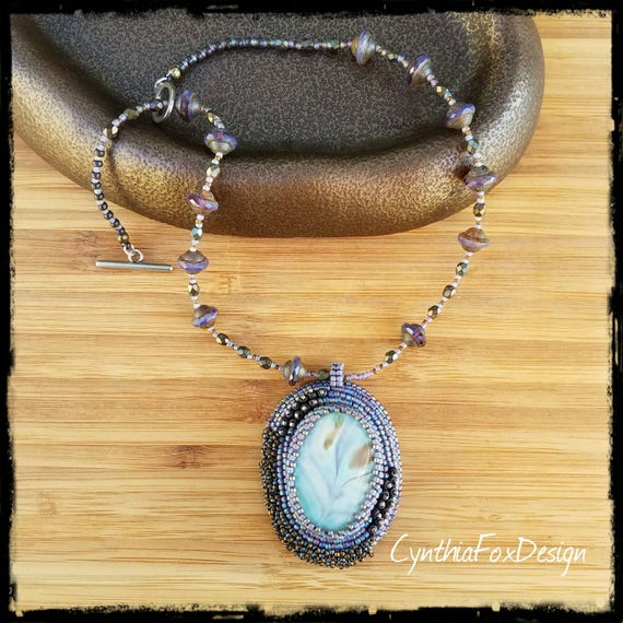 Peacock Blue Necklace,  Pendant on Lavender Saturn Glass Beaded Necklace