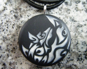 Silver Wolf Moon hand carved on a polymer clay black color background. Pendant comes with a FREE necklace